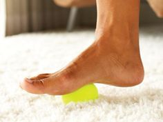 Home cure for achy feet: Mini massage that stretches & soothes your arches. Slip off your shoes & roll each foot over a tennis ball for a minute or two. To cool throbbing feet roll over frozen water bottle.