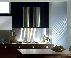 The new Cylindra wall hood by Faber shown in a modern kitchen to the left (with two hoods side by side), is a great addition to the Faber. Kitchen Vent Fan, Kitchen Exhaust, Kitchen Hoods, Kitchen Tiles, Chimney Range Hood, Kitchen Chimney, My Kitchen Rules, Industrial Style Kitchen, Cool Kitchens