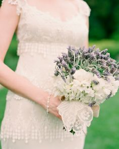 The bride's spring-inspired bouquet was a combination of lavender, sweet peas, and gardenias, with a handkerchief belonging to her great grandmother tucked in.