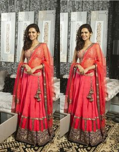 #EshaGupta in a beautiful coral colored designer bridal lehenga