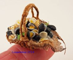 scallops, clams & mussels in a handwoven basket