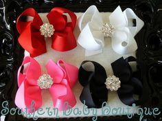 Twisted bows with fancy rhinestone centers