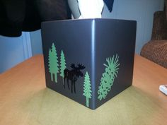 Plain brown tissue box decorated with Cricut images and vinyl. #cricut #imadeit