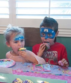 Captain America and princess Elsa zoned out eating cup cakes Face Paintings By one of San Diego's Top Face Painters Ramona Williams.  www.welike2partysd.com www.facebook.com/welike2partysd  #bouncehouseRentalsSanDiego  #FacePaintingSanDiego #kidsparty #kidsparties#facepainting  #welike2partsd #hairfeathers   #mobilepettingzoo #mobileminipettingzoo #welike2partysd.com