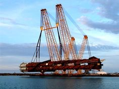 The largest heavy-lift device in the Gulf of Mexico hoists the 7,200t Red Hawk cell spar from barge to water. - Image - Offshore Technology