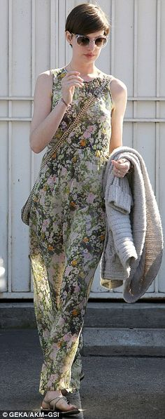 Anne Hathaway in a floral maxi dress, oversize cardigan, and Stella McCartney Faux Python bag