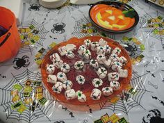 Halloween Food - eyeballs  Would go well with a chocolate fountain.