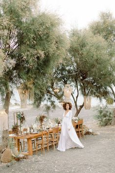 Santorini weddings are not always cliffside! This intimate boho beach wedding is living proof that tablescapes where sand meets sea and ceremonies beneath bamboo porticos are equally as mesmerizing. Wispy grasses, dried palms and native island blooms fill every frame in this wedding story, and a bridal jumpsuit offers a perfect representation of the energy at the center. More macrame wedding ideas where this comes from!