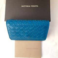 Authentic Bottega Veneta Leather Card Case Color: Empire 4303. In excellent condition. With box and authenticity card. Has a light discoloration on the back. Bottega Veneta Bags Wallets