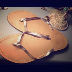 Jcrew Made in Italy leather Capri sandals, silver JCrew retail leather Capri sandals. Beautiful Italian leather sole and thong. Light warm tan sole with silver accent. Size 7, fit TTS. Worn, but still in good shape and lots of life! J. Crew Shoes Sandals