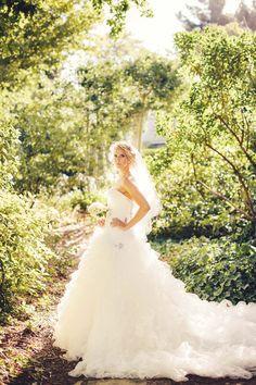 stunning bride in the garden in a big wedding dress. #bigweddingdress #outdoorwedding