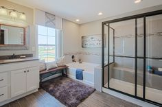 A walk-in shower with accent tiles and glass doors, as well as a separate bath tub, would be perfect for the master bathroom in your new home. Seen in the Morris at Ballyshannon located in Union, KY. | Fischer Homes