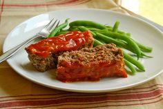 This meatloaf recipe is hearty, easy and oh so delicious. Once you've tried it, you'll be craving it all the time. Trust me.