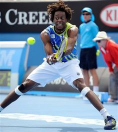 French expressionist Gael Monfils muscles a backhand in his first-round victory. Gael Monfils, Ap French, First Round, French Language, Tennis Players, Victorious, Muscles, Culture, Sports