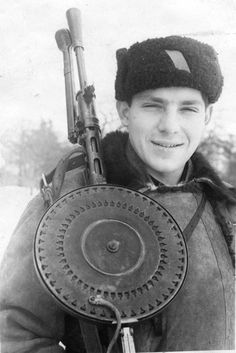 Young partisan with his 7.62 mm Degtyarev machine gun in the vicinity of Kharkov, Ukraine, winter 1943.