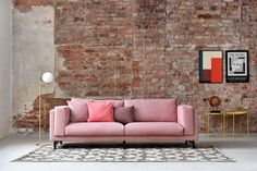 think pink | red brick walls, industrial chic vibes | pink sofa, minimal living room decor | flos floor lamp | IKEA Nockeby sofa with a Bemz cover in Rose Brunna Melange from our Respect collection made of 100% recycled material