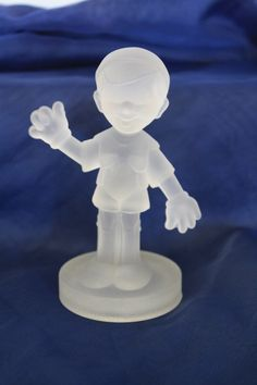"""Glass Pinocchio figurine It measures approx: 5"""" tall x 2.5""""D. It is on excellent condition. There are no cracks-the bottom pic is just manufacturer flaws. On sale for $20 FREE SHIPPING Please email me at paulinespenny@yahoo.com with any questions Thank you for looking"""
