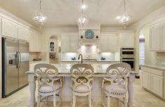 Traditional Kitchen with Limestone Tile, limestone tile floors, Breakfast bar, Kitchen island, Custom hood, Raised panel