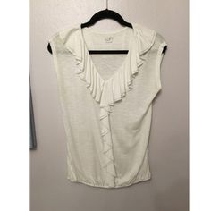 Ann Taylor Loft Top Perfect condition. Completely white with subtle Ruffles and a V-Neck. Comfortable cotton material. Size small but would fit a medium as well. LOFT Tops