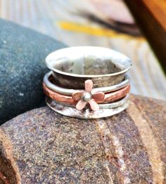 A personal favourite from my Etsy shop https://www.etsy.com/uk/listing/245572444/spinner-flower-ring