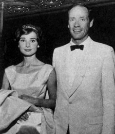 """The actress Audrey Hepburn photographed with her husband Mel Ferrer (actor, dialogue coach and film director) during their arrival at a party following the premiere of """"The Big Country"""" in Los Angeles, California (USA), on August 22, 1958. Audrey was..."""