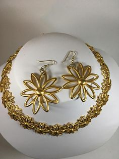 Anne Klein daisy necklace and pierced earring set in beautiful gold tone is sure to brighten your day and liven your spirits. Necklace contains the stamped Anne Klein hang tag. Approximate measurements: Necklace - 45 cm X cm X Earrings- 7 cm X cm X 1 Anne Klein, Daisy Necklace, Brighten Your Day, Hang Tags, Earring Set, Gold, Etsy, Beautiful, Jewelry