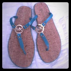MICHAEL KORS Monogram Sandals Brand NEW!! Never worn!! Size Tag is still on the bottom • Rubber and cork sandals • gold monogram • color: turquoise • Size: 10 MICHAEL Michael Kors Shoes Sandals