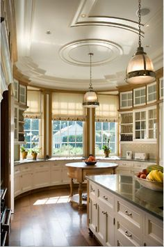 may be the prettiest kitchen I have ever seen.  Look at that ceiling, the curve, the color, lights, everything including the view out the window is perfect!