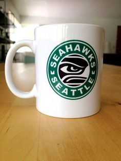 Seattle Seahawks Coffee Mug Original courtney2k design. Mock Starbucks graphic on one side, Lombardi 12 Trophy graphic on the other.