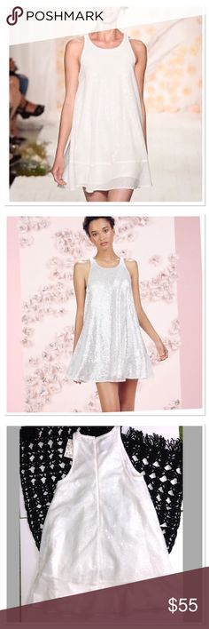 """LC Lauren Conrad Runway white sequin swing dress LC Lauren Conrad stunning Runway Collection gardenia (white) sequin swing dress will make a bold statement All-over sequins shimmer and shine, giving you a glamorous, youthful look. This will be perfect for a wedding or special event!  FEATURES: Flounce hem, Crewneck with back hook-and-eye closure. Sleeveless Fully Lined.  Size 2. Pit to pit: 17"""" approx length 32""""  Flowing swing design, Back zipper, Polyester, Hand wash, Lined. LC Lauren…"""