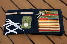 "Things to buckle, tie and button. A ""wallet"" holding cards and keys."