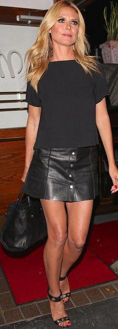 Who made  Heidi Klum's black leather handbag, snap mini skirt, and sandals?