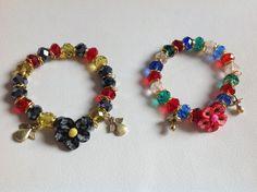 pulseras en muranos multicolores elasticadas, aplicacion dije rosa en fimo diseños de color beads.