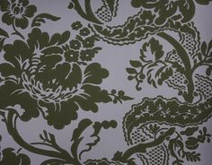 Versailles Wallpaper An elegant damask style wallpaper printed in black on a purple background.