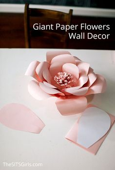 Perfect for bringing spring inside any time of the year - giant paper flowers wall decor. Mix and match colors and the sizes of your flowers to make a stunning feature wall for your next party. Easy step by step instructions, a video tutorial, and templates to help you create the perfect flowers.