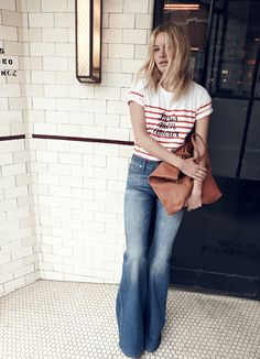 "madewell et sézane, july 2015: our french-american muse camille rowe wearing the striped ""paris mon amour"" t-shirt + madewell flea market flares. #madewellxsezane"
