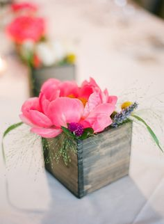 Pink peonies nestled in wooden boxes
