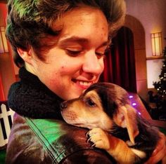 Brad with a puppy on The Paul O'Grady Show <3 I think that puppy totally fell in love with Brad and doesn't wanna let go...awwww
