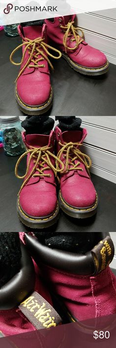 BERRY RED DR. MARTENS BOOTS Berry red leather lace up boots with Air Wair Bouncing Soles, signature yellow lacing around sole. WORN ONLY A FEW TIMES. LIKE NEW CONDITION  SMOKE FREE HOME  REASONABLE OFFERS WELCOME Dr. Martens Shoes Combat & Moto Boots