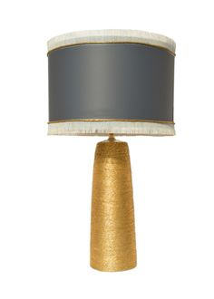 The Ro Sham Beaux  Myvica Gold Table Lamp offers an Art Deco era style for a modern theme. Created in a gold hemp wrapped base, with brass hardware, finished with a grey chintz shade with fringe.