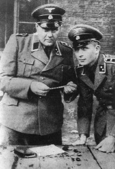 Two SS officers with confiscated Jewish property in the Lodz ghetto.