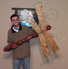 RUSTIC Utah Item # 40: Extra large dragonfly garden art or wall art. Made from a table leg and fan blades. Wings are painted green, orange, and red. Body is red and brown.