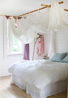 I like the idea of using cheap bamboo and painting it to hang the lace from.