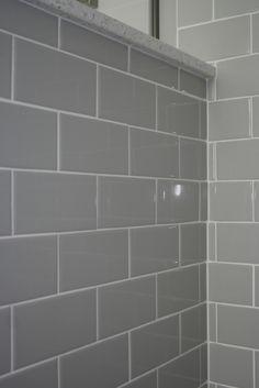 Shower cap wall in Glacierstone with Daltile Ceramic tile in Dessert. #RhodeIslandBathroom