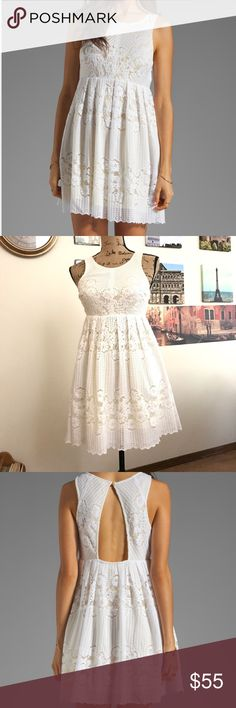 """Free People Rocco lace dress in white sz. 0 This darling dress is made for summer picnics at the park!!!  Features white lace fabric with a sunny yellow underlay.  Measures 14"""" pit to pit, flat laid, 13.5"""" waist, flat laid-front only, and is 32"""" in length.  0111110117  EUC Free People Dresses"""