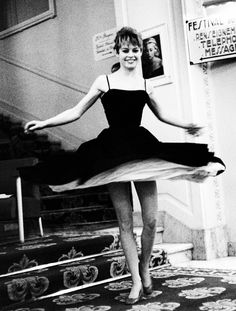 Brigitte Bardot twirling around in a tight-waist dress with lots of shape! #styleicon #modcloth