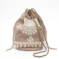 Fabric bag -- Nice visual interest on the outside.  Use of long roping makes for versatile use.