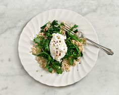 Poached eggs over greens & toasted couscous