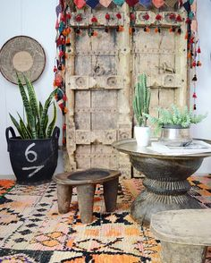 african senufa stools, binga basket, indian door, indian grinder, moroccan boujad rug, #succulents , turkish rubber coal basket, uzbek wall hanging #ihavethisthingwithtextiles —  by apartmentf15