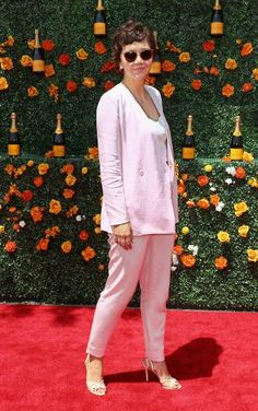 Maggie Gyllenhaal wears a pink suit for the Veuve Clicquot Polo Classic.
